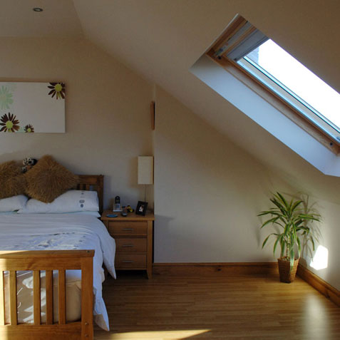 Loft conversion bedroom with velux windows