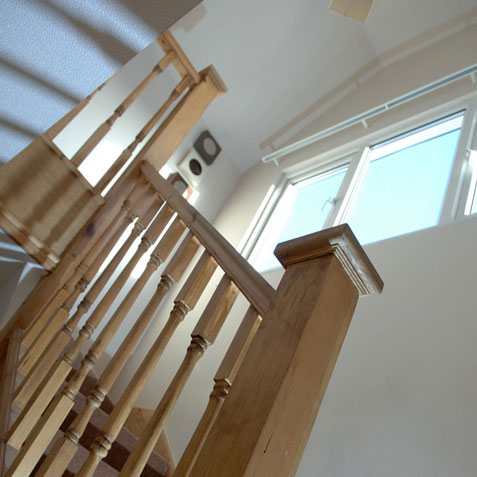 Staircase banister leading to loft conversion
